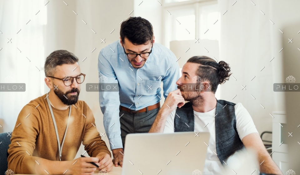 demo-attachment-505-group-of-young-businesspeople-with-laptop-working-8SHTZUN